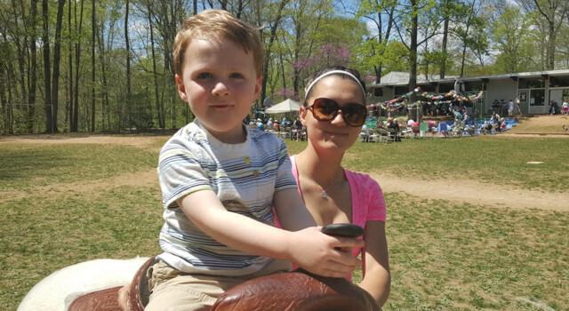 Beckett at May Fair Riding a Pony